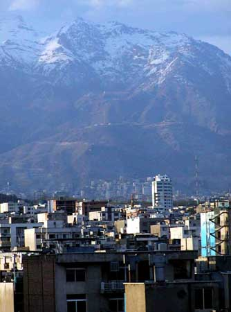 Classic view of Teheran with mountains on the background.
